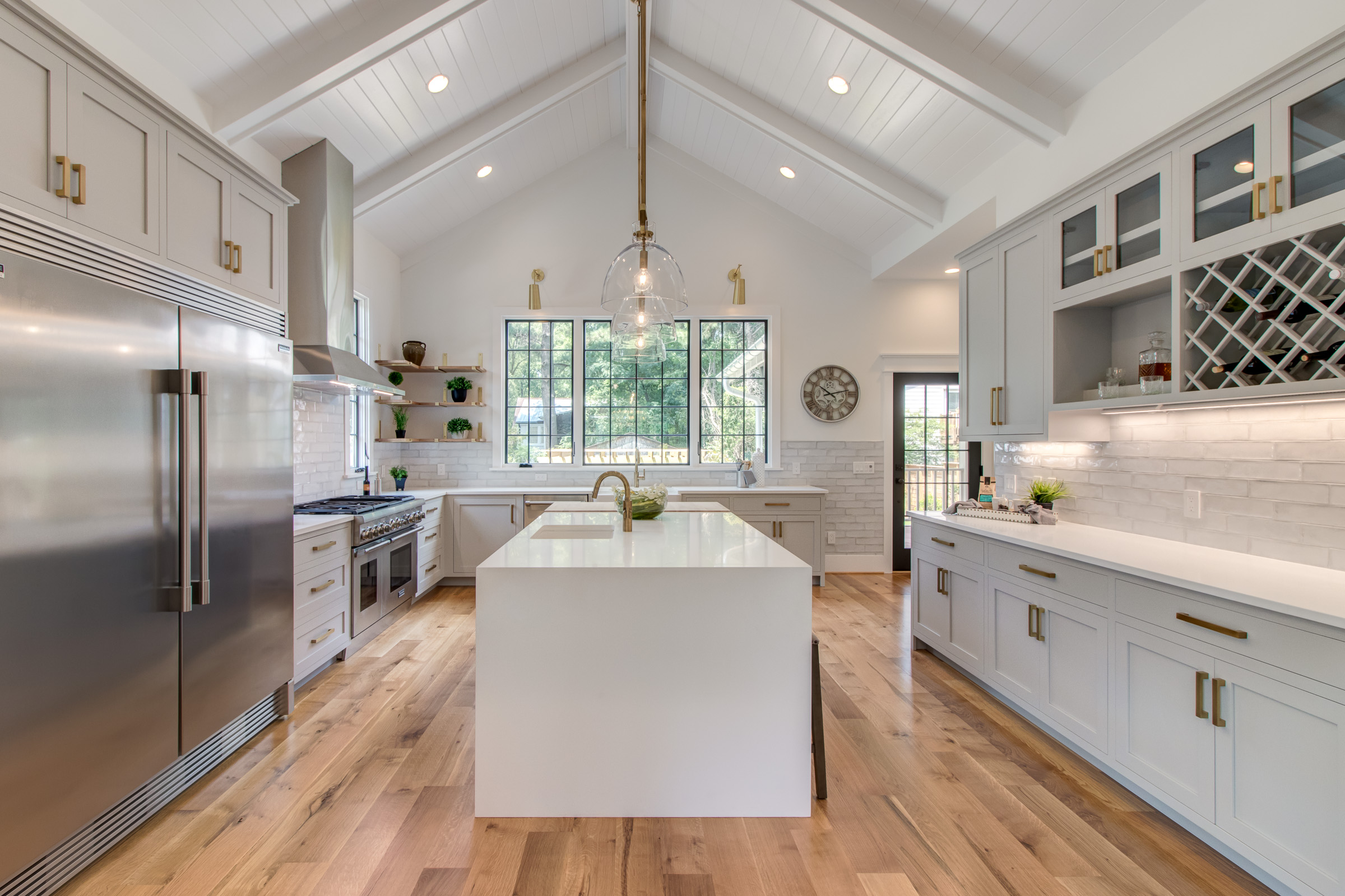 Modern kitchen with vaulted ceilings and waterfall counter top.